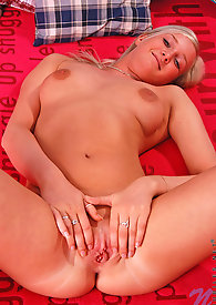 Cover girl Kadri squeezes her boobs on the bed while spreading her legs really wide