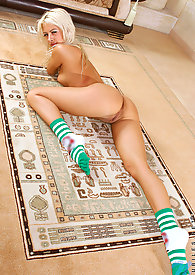 Long haired nubile stunner bares off her tempting body and teasing on the floor