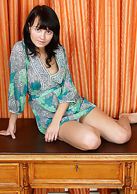 Fresh seductive Nubile Delia bends over and fondles her tight pussy on top of the table