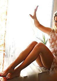 Beautiful teen Bodana with a sexy body poses naked near the window